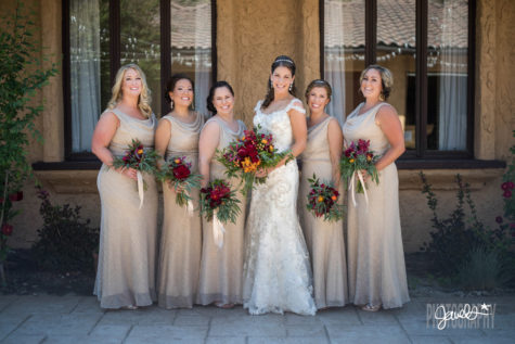 colorado gold bridesmaids dresses red flowers