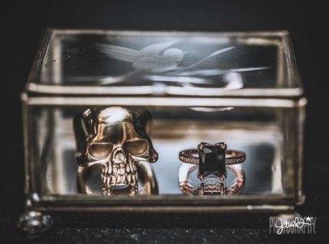 black and gold wedding rings details skull